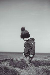 Boy standing on beach - Banff, Aberdeenshire