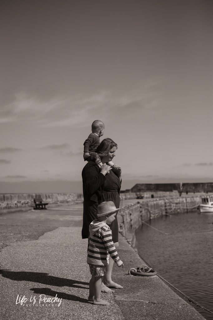 Family looking into harbour water