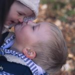 Boy kissing baby - Leith Hall, Aberdeenshire