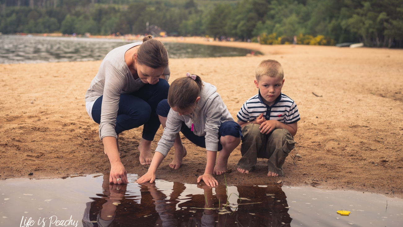 Family looking into water Loch Morlich. Family photographer Aberdeenshire and Moray
