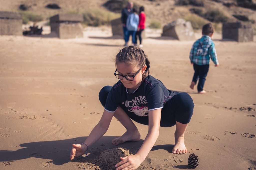Girl making sandcastle